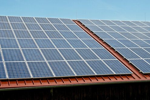 Germany, Constance, Solar panel on roof of a barn - JEDF000205