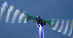 Illuminated swing on a funfair at night - WG000552
