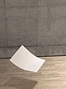 Blank sheet of paper falling to wooden floor - UWF000297