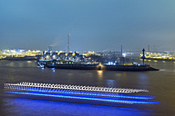 Germany, Hamburg, harbor at night with ship passing by - RJF000369