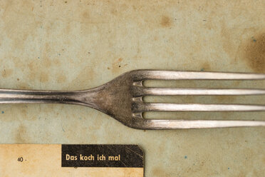Silver fork and part of an old recipe on stained paper - MYF000777