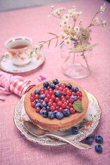 Still life with blueberries and red currant on the rural style table - VTF000367