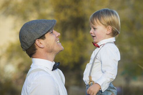 Happy father and son outdoors - JTLF000007