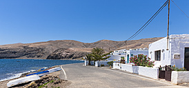 Spain, Canary Islands, Lanzarote, Puerto Calero, empty street at Playa Quemada - AMF003480