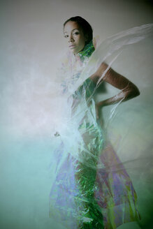 Young woman wrapped in rainbow foil - VEF000019