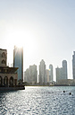 Arabia, United Arab Emirates, Dubai, Skyscrapers against the sun - JUNF000133