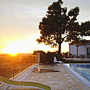Spain, Majorca, evening light in a small hotel complex, pool, tree and house, mediterranean style - MS004403