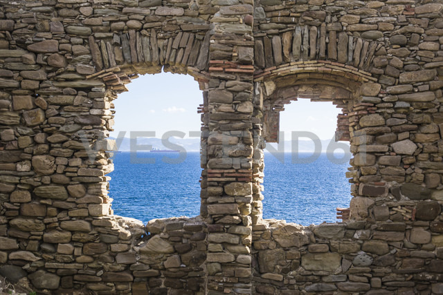 Spain, Andalusia, Tarifa, view through windows of ruin to the sea - KB000263