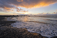 Spain, Canary Islands, La Gomera, Valle Gran Rey, evening at shingle beach - SIE006324
