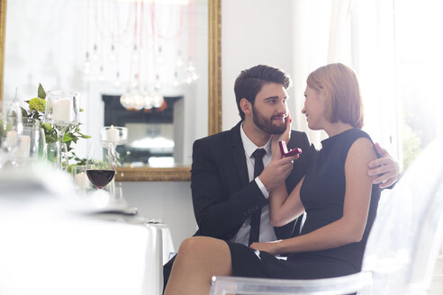 Elegant couple with engagement ring in restaurant - WESTF020408