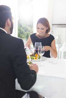 Elegant couple having dinner in restaurant - WESTF020420