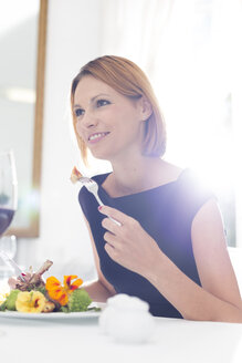 Elegant woman having dinner in restaurant - WESTF020423