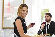 Elegant couple having dinner in restaurant - WESTF020426