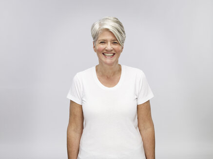 Portrait of mature woman with grey hair in front of light background - RH000460