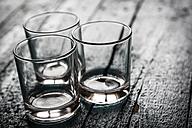 Three empty glasses on wood - SARF001194