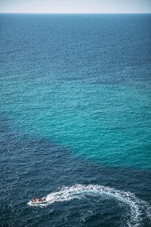 Spain, Balearic Islands, Menorca, Cala Enturqueta, view of a motor boat in the sea - EHF000004