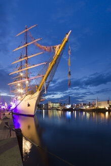 Germany, Bremerhaven, Illuminated ships in harbour during festival - SJ000133