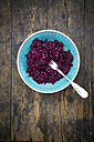 Bowl of prepared red cabbage on dark wood - LVF002534