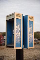 USA, Hawaii, Big Island, Hapuna Beach, public phone ornate with stylized Hawaiian hibiscus - BR000966