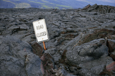 USA, Hawaii, Big Island, Volcanoes National Park, sign lost in lava field - BRF000944