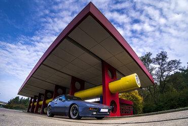 Germany, Berlin, sports car at gas station - BIG000048