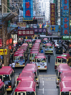 China, Hong Kong, Kowloon, street scene with advertising and taxi busses - WE000323
