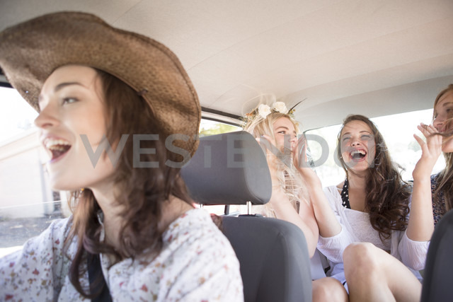 South Africa, Friends on a road trip driving in car - ZEF002680