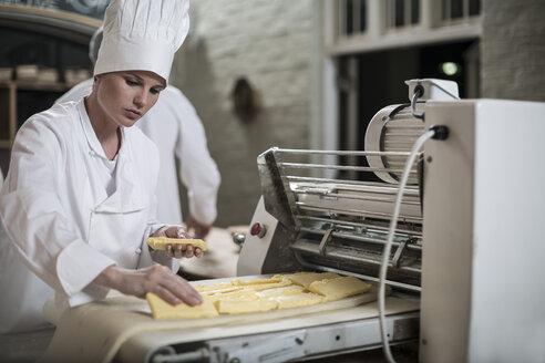 Femal baker preparing dough - ZEF003772