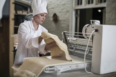 Femal baker preparing dough - ZEF003775