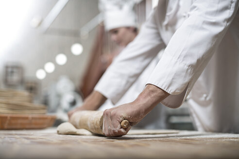 Baker rolling out dough - ZEF003789