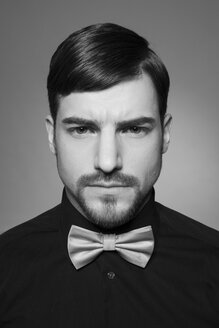 Portrait of serious looking man wearing bow and black shirt - SHKF000102