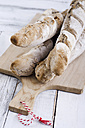 Home-baked baguettes on wooden board - ODF000973