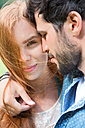 Young couple sharing an intimate moment outdoors - WESTF020682
