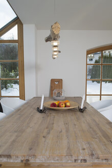 Fruit bowl and candle holders on wooden table - FF001426