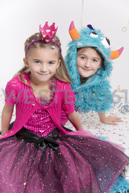 Two smiling girls masquerade as a princess and monster - YFF000294