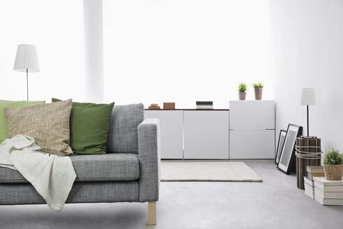 Modern living room with couch and sideboard - PDF000670