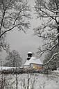 Germany, Kochel am See, snow-covered Protestant Church at twilight - LAF001379
