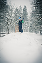 Germany, Bavaria, Berchtesgadener Land, boy with sledge in winter landscape - MJF001378