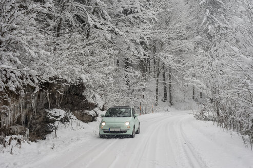 Germany, Bavaria, Berchtesgadener Land, car on rural road in winter landscape - MJF001393