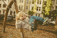 Toddler having fun on a swing - MFF001359