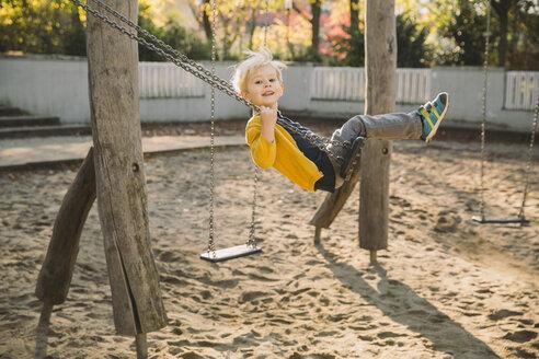 Toddler having fun on a swing - MFF001361