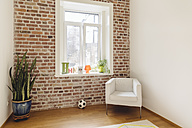 Room with brick wall in modern building - MFF001372
