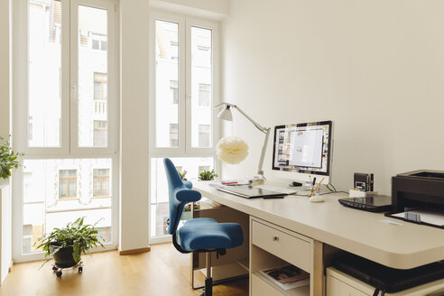 Home office with computer desk in modern building - MFF001373