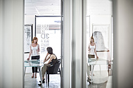 Businesswomen having a meeting in conference room - ZEF003094