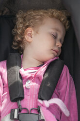 Little blond girl sleeping in car seat - NNF000311