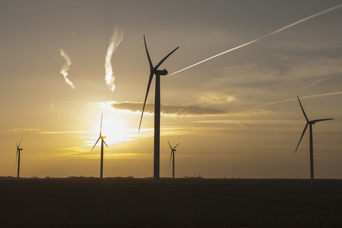 Netherlands, Zeeland, wind turbines at sunset - NNF000326