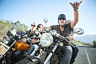 Friends riding motorcycles on open road - ZEF003577