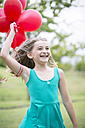 Portrait of smiling girl with red balloons - ZEF004392