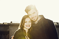 Portrait of happy young couple in backlight - MEMF000625