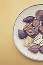 Chocolates on plate and yellow background - LVF002587